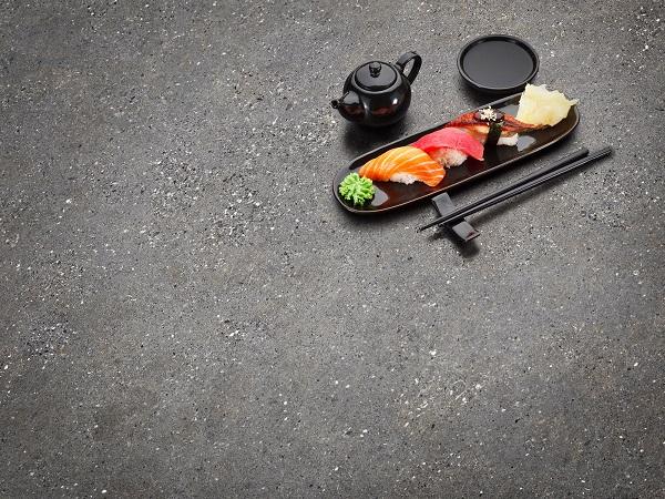 Tuna,,Salmon,And,Eel,Sushi,Nigiri,On,The,Black,Table